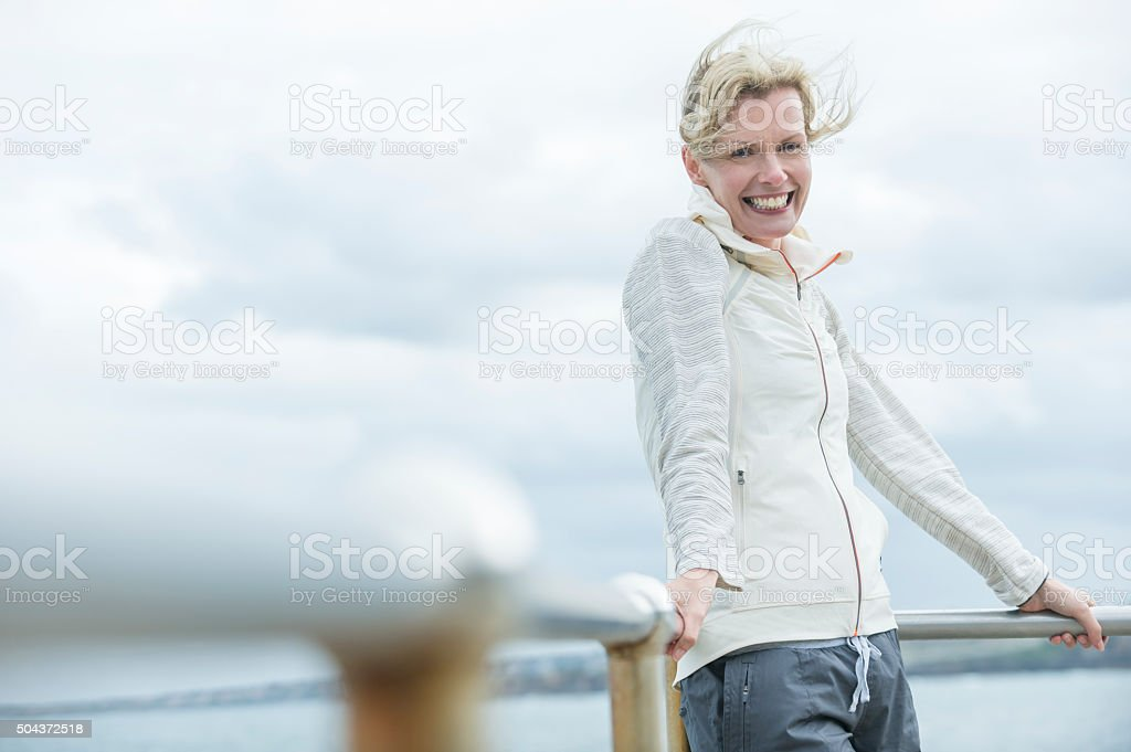 Mature woman smiling outdoors. stock photo
