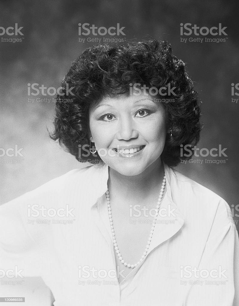 Mature woman smiling, portrait stock photo