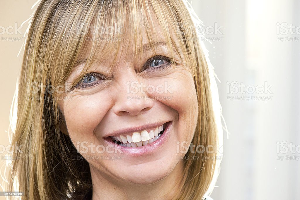 mature woman smiling to camera stock photo