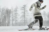 Mature woman snowshoeing