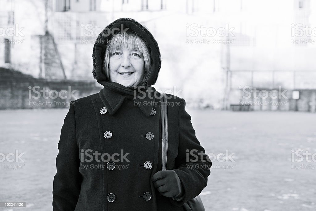 Mature Woman Standing in the Arenes De Lutece stock photo