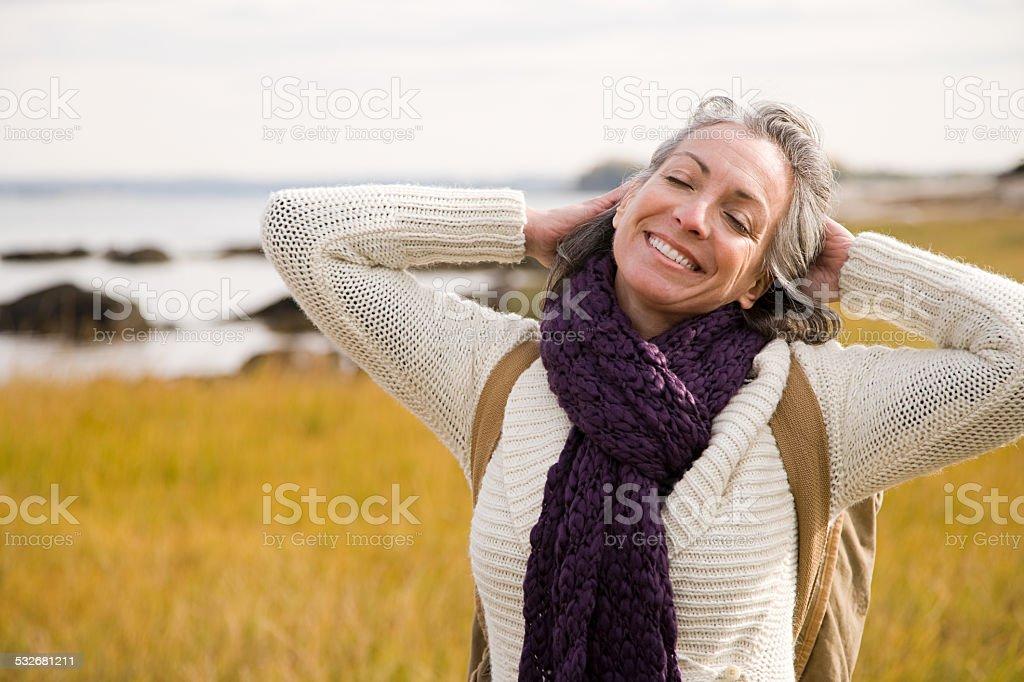 Mature woman stretching stock photo