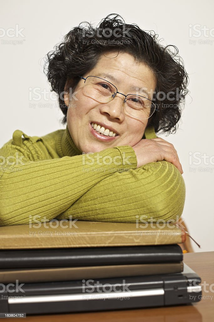 Mature woman studying at home stock photo