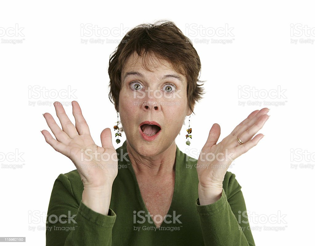 Mature woman surprised in green royalty-free stock photo