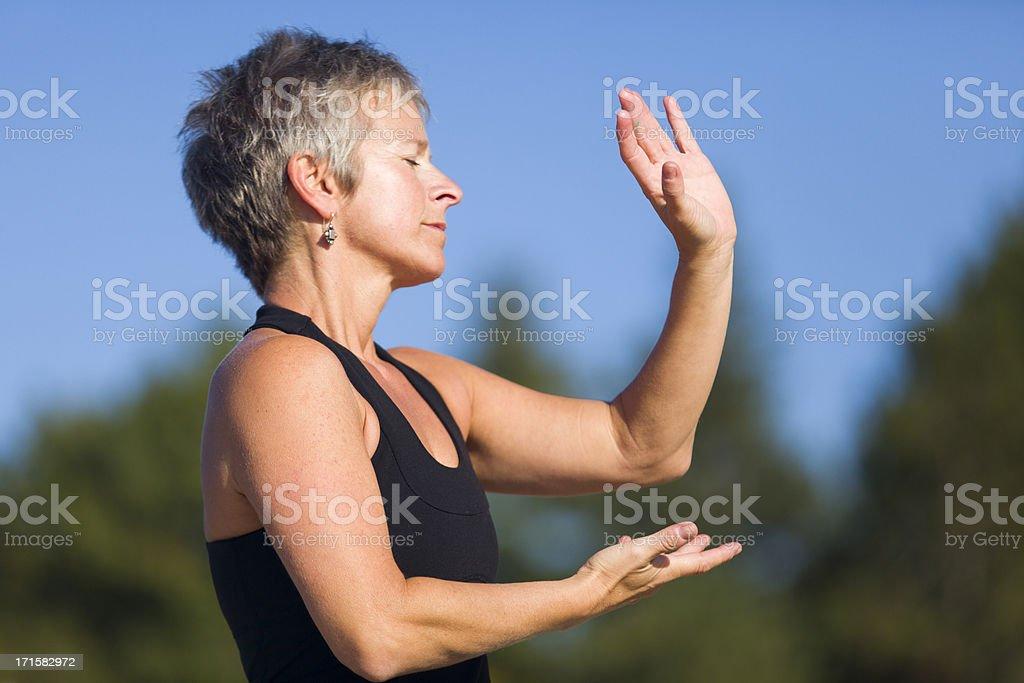 mature woman tai chi fitness stock photo