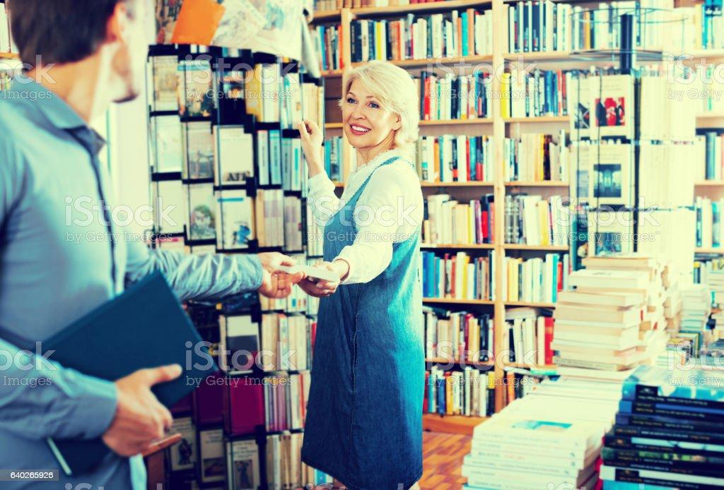 mature woman taking book stock photo