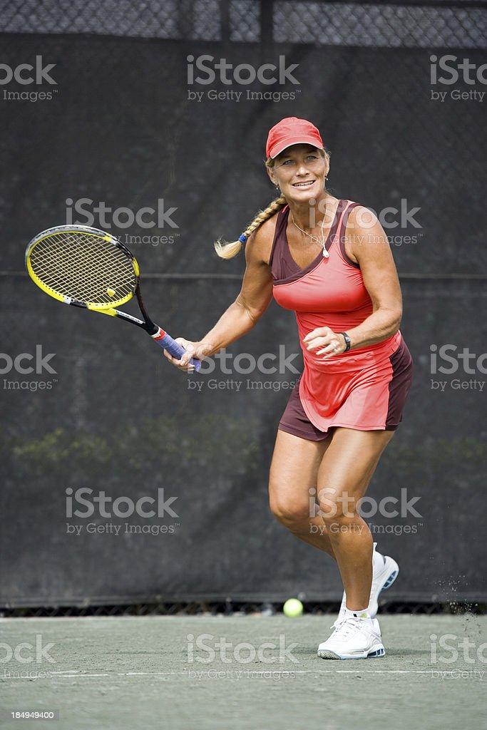 mature woman tennis player stock photo