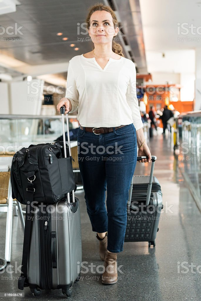 mature woman travelling stock photo