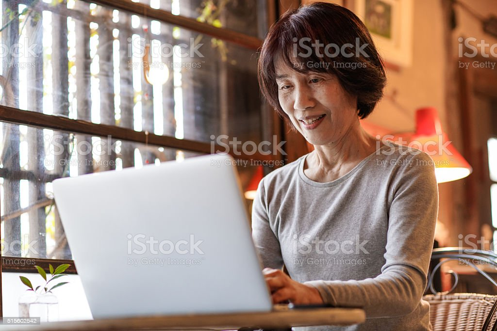 Mature woman using a computer stock photo