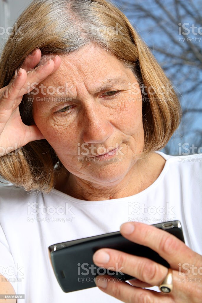 Mature Woman using Cellphone royalty-free stock photo
