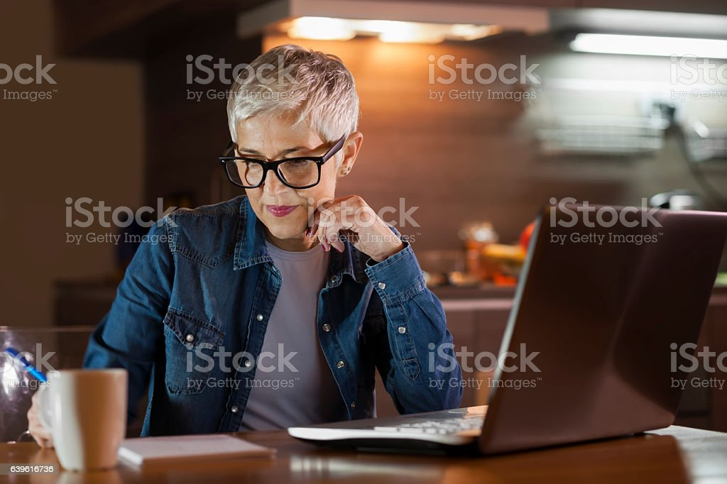Mature woman using computer stock photo