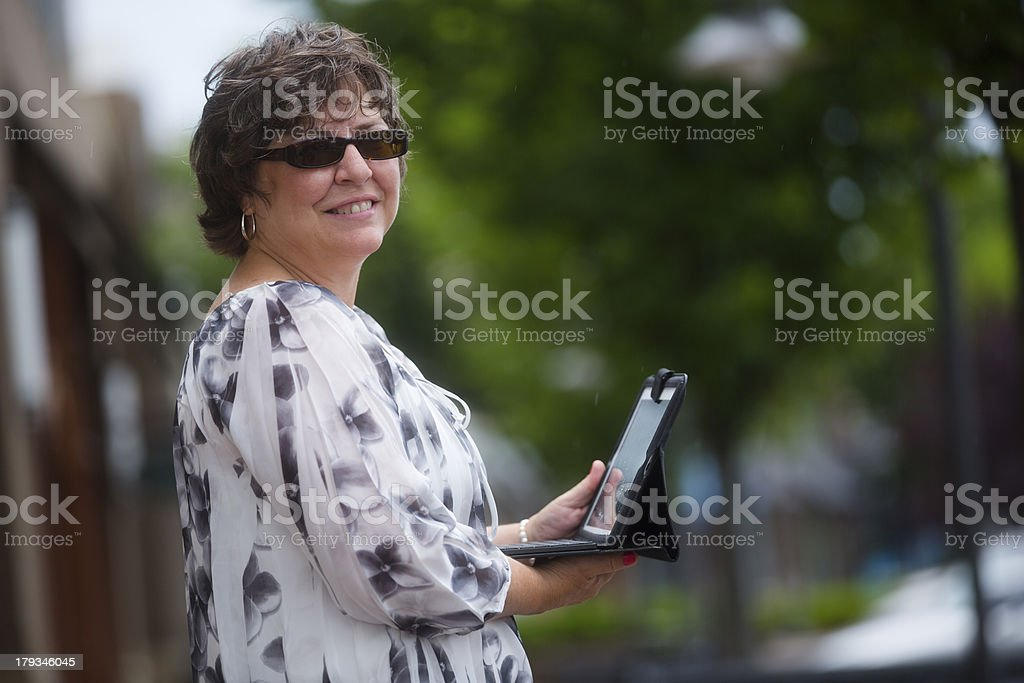 mature woman using tablet stock photo