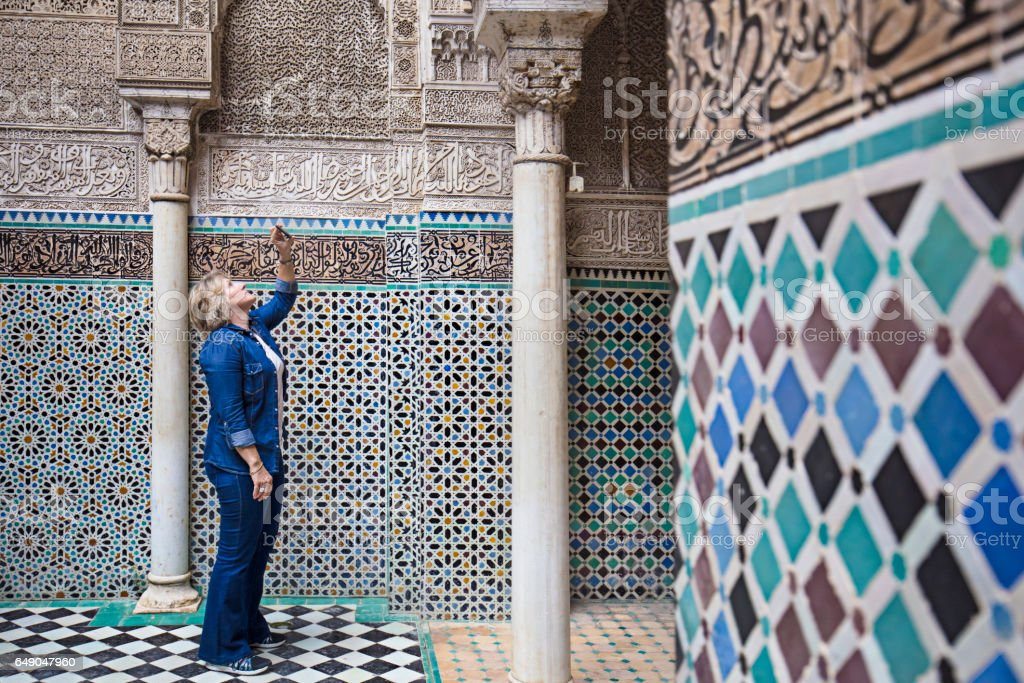 Mature woman visiting Attarine Madrasa in Fez stock photo