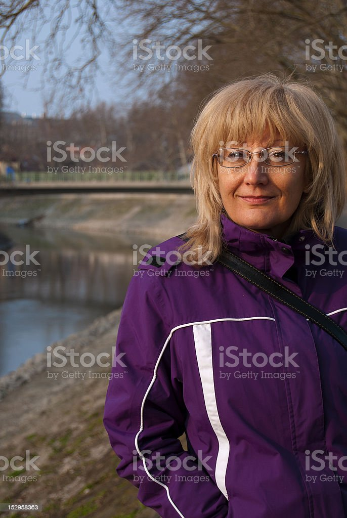 Mature woman walking by the river royalty-free stock photo