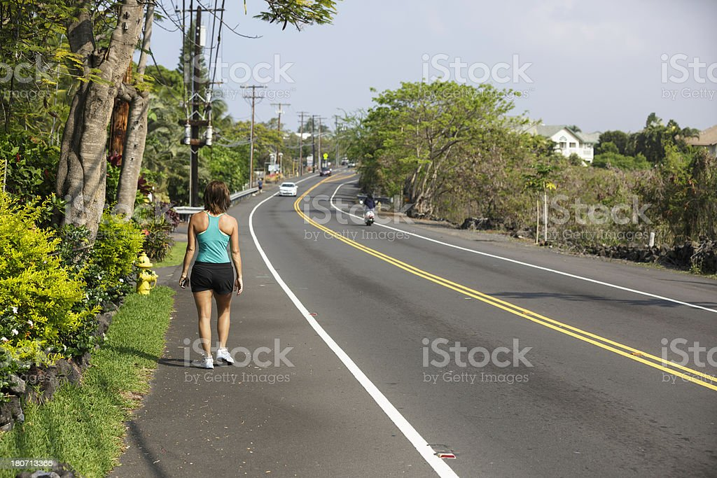 Mature Woman Walking in the Tropics stock photo