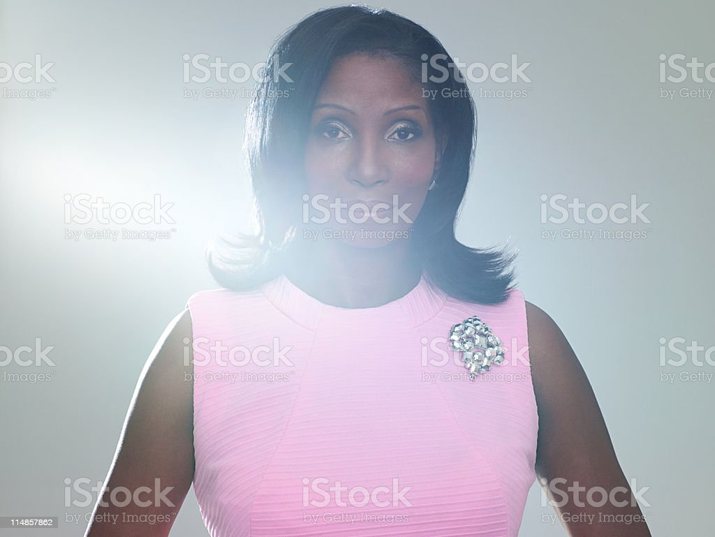 Mature woman wearing pink dress, portrait stock photo