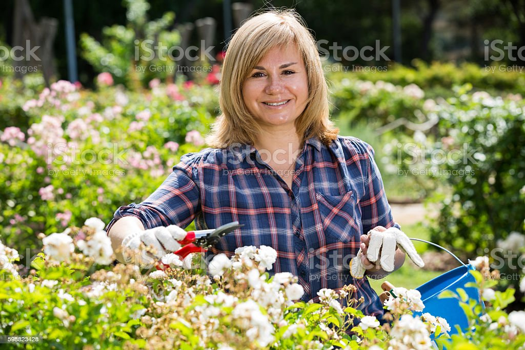 mature woman white flowers stock photo