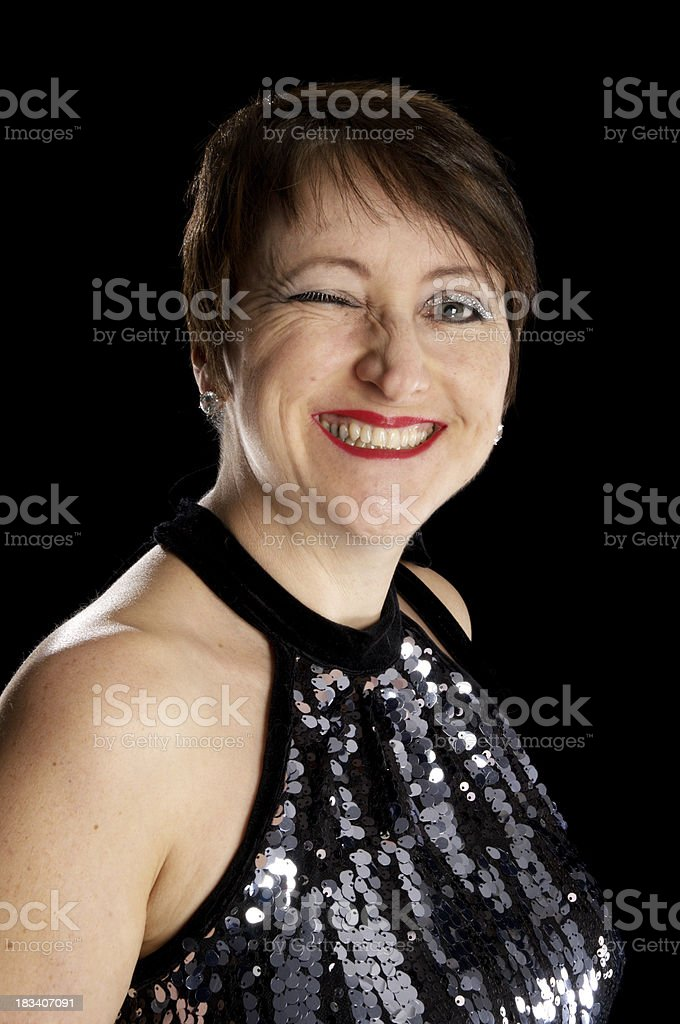 Mature woman winking wearing sequins. stock photo