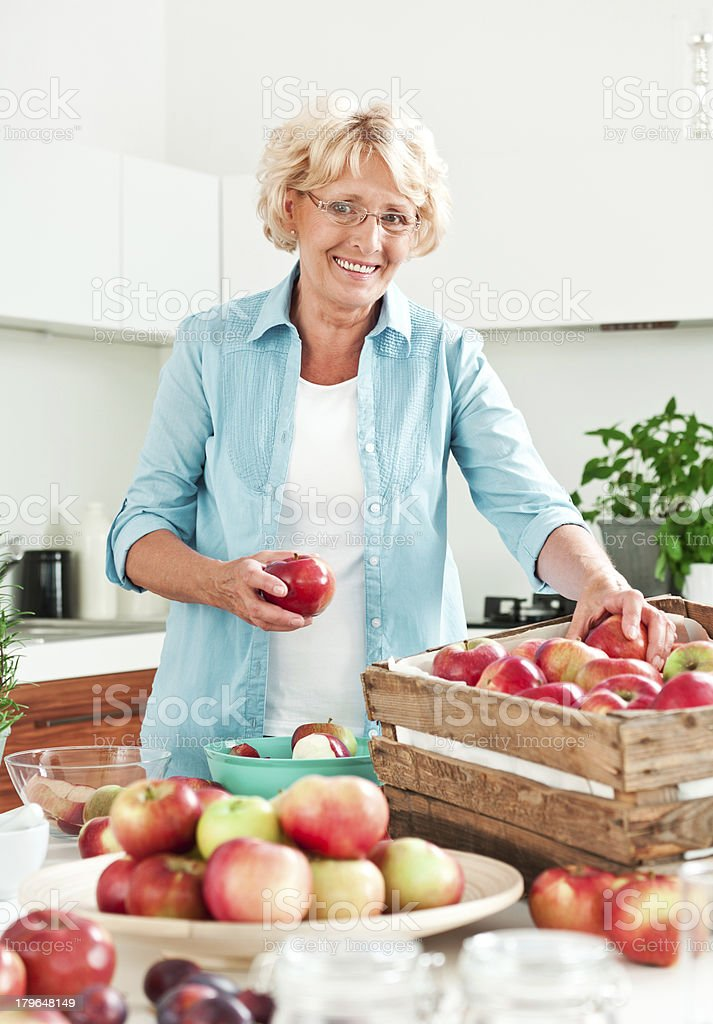 Mature woman with apples stock photo
