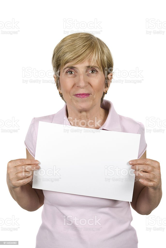 Mature woman with blank sign royalty-free stock photo