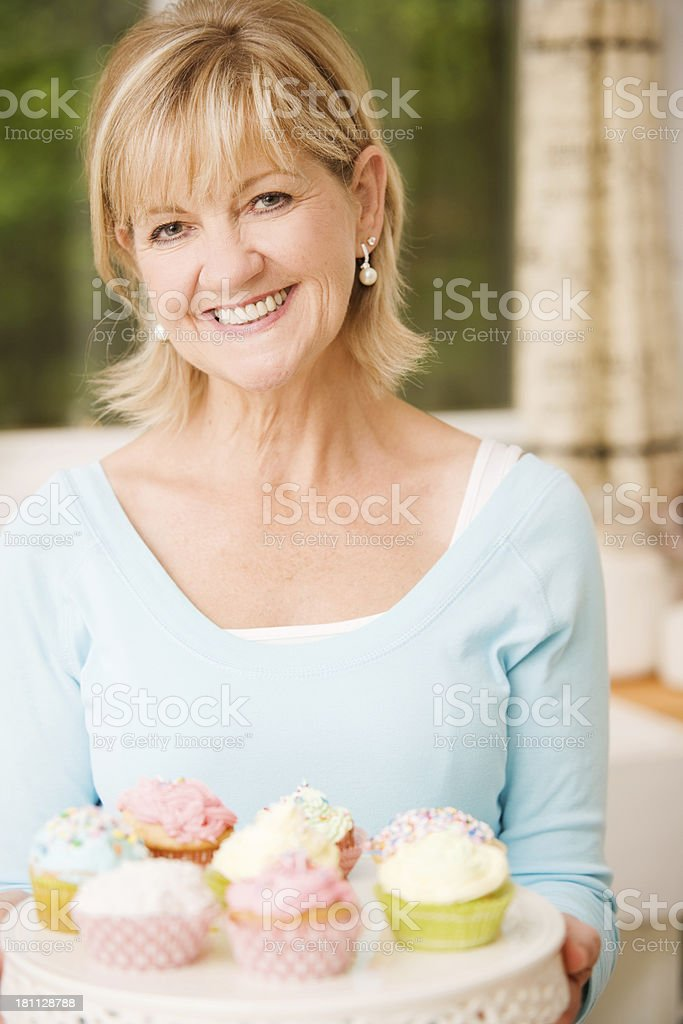 Mature Woman With Cupcakes royalty-free stock photo