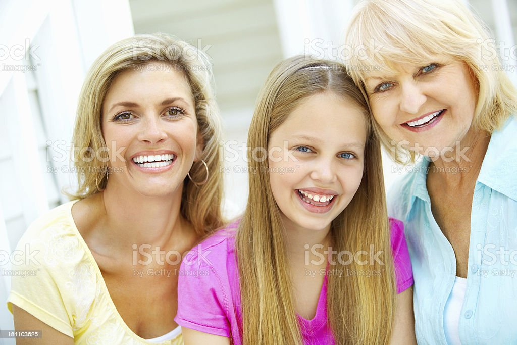 Mature woman with cute granddaughter and daughter royalty-free stock photo