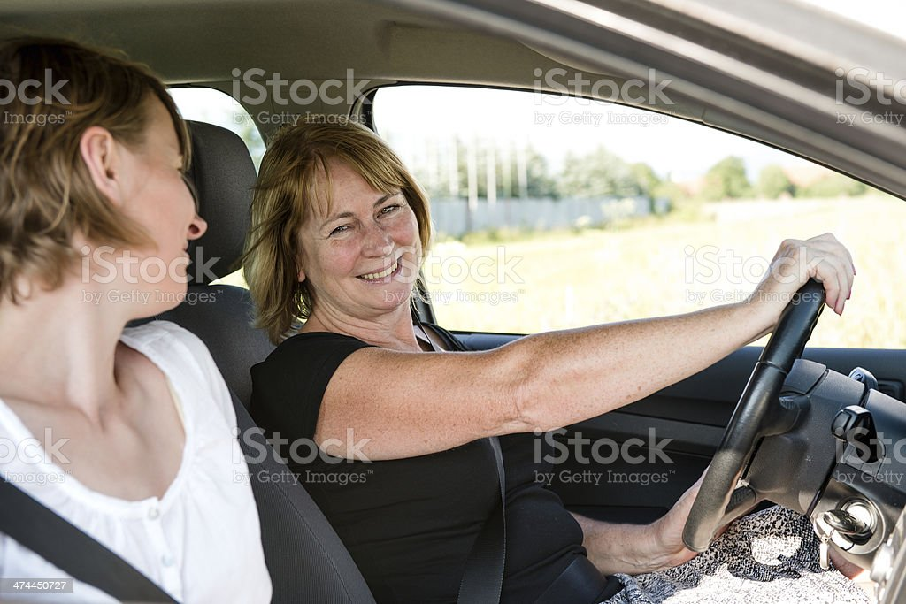 Mature woman with daughter driving car royalty-free stock photo