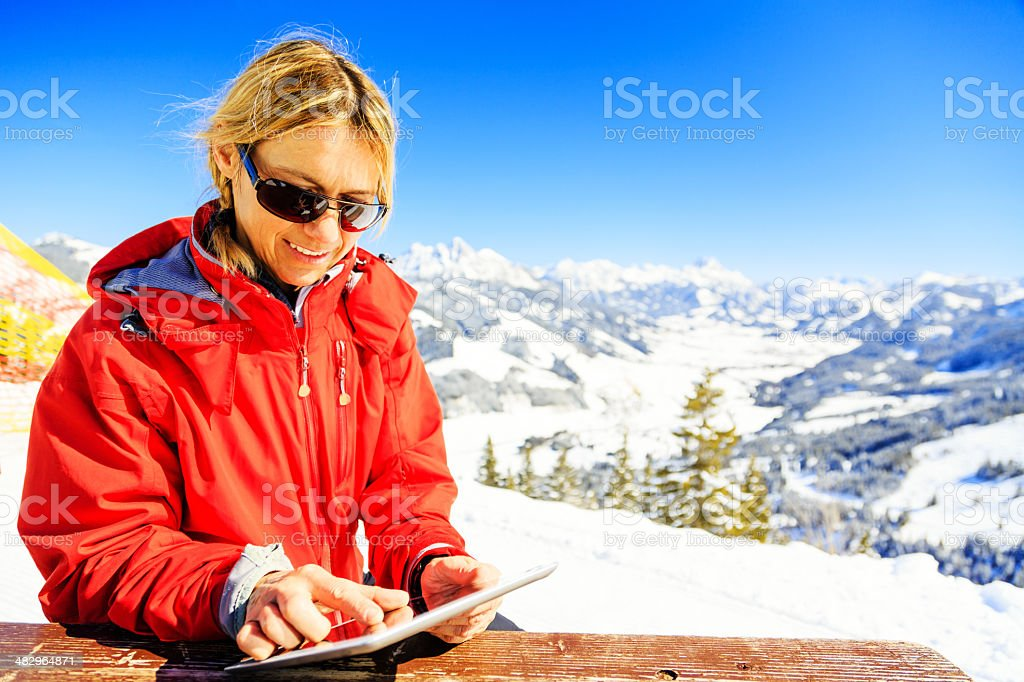 mature woman with digital tablet royalty-free stock photo