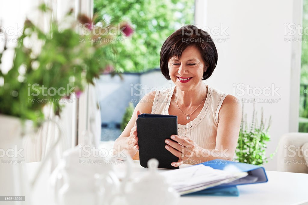 Mature woman with e-reader royalty-free stock photo