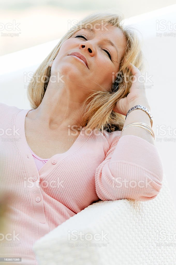 Mature woman with eyes closed resting stock photo