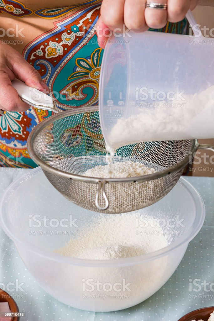 Mature woman with flour in kitchen stock photo