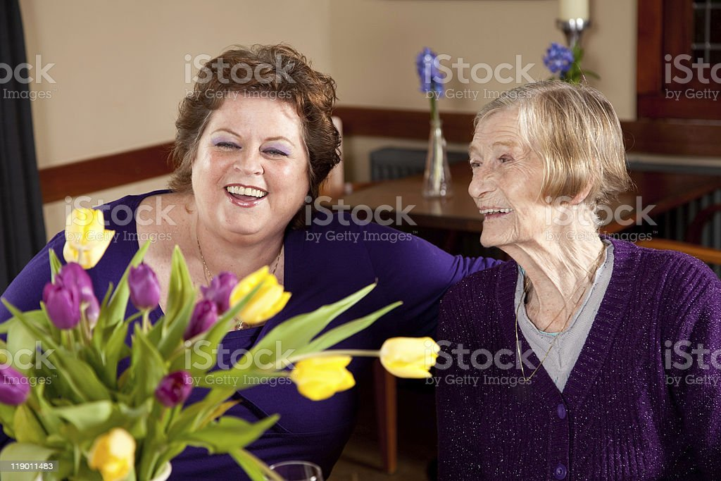 Mature woman with her 80 year old mother royalty-free stock photo