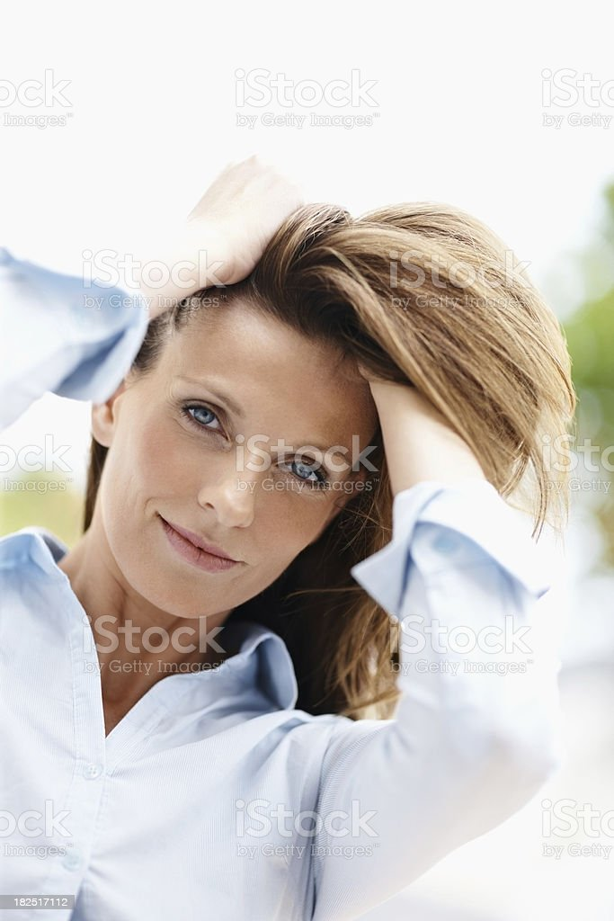 Mature woman with her hands in hair royalty-free stock photo
