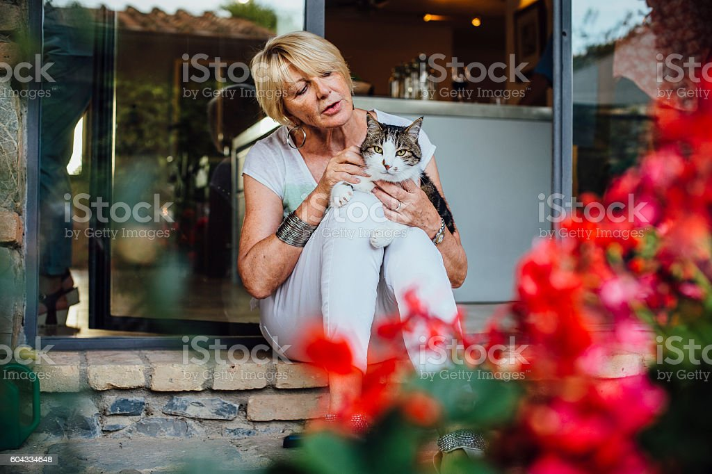 Mature Woman with her Pet Cat stock photo
