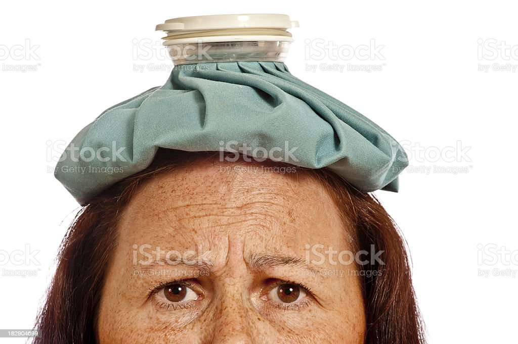 Mature Woman With Ice Pack For Headache royalty-free stock photo