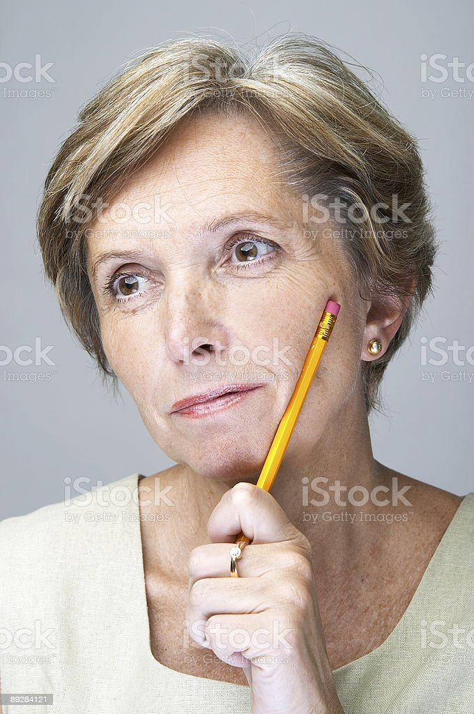 Mature woman with pencil royalty-free stock photo