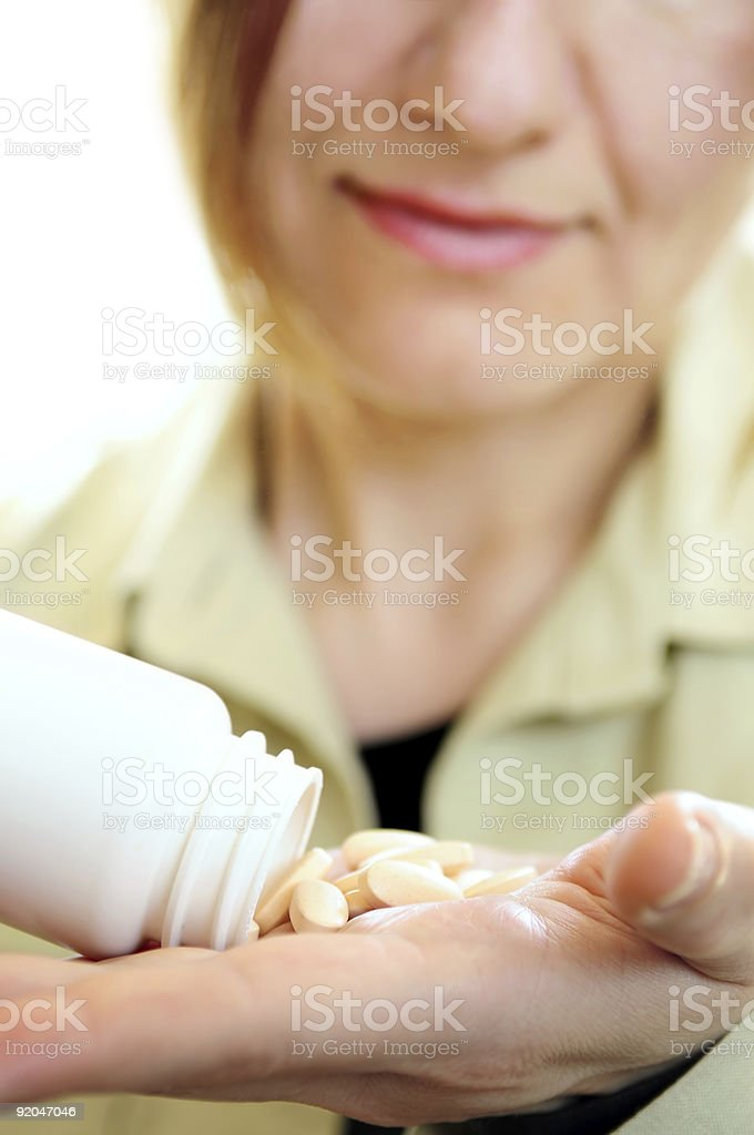 Mature woman with pills royalty-free stock photo