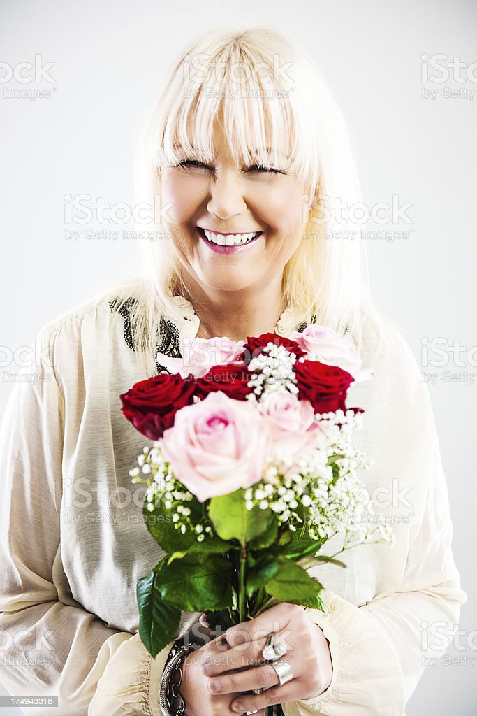 Mature woman with roses royalty-free stock photo