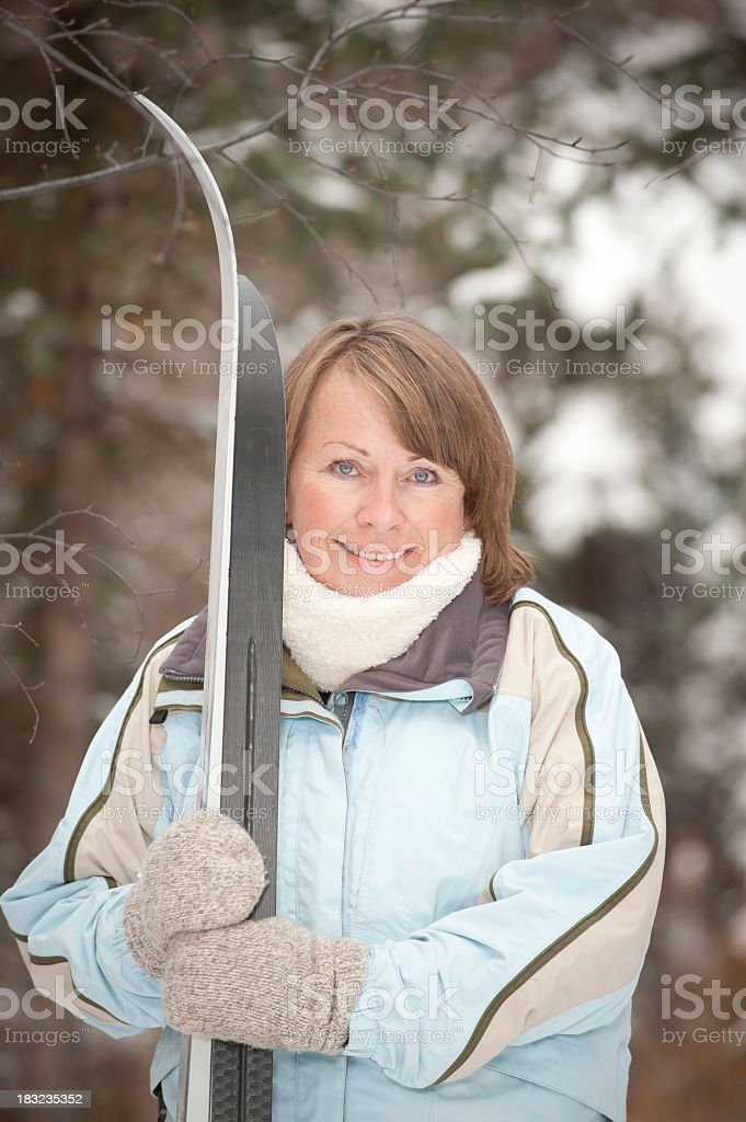 Mature Woman with Skis. royalty-free stock photo