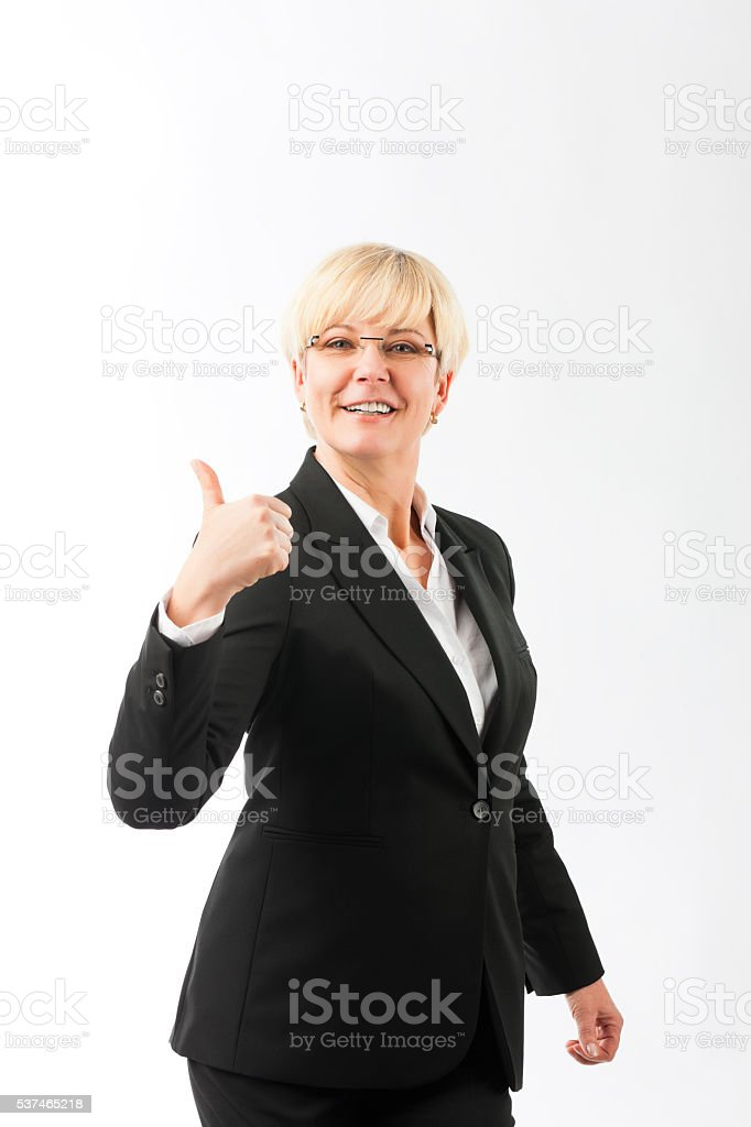 Mature woman with thumbs up stock photo