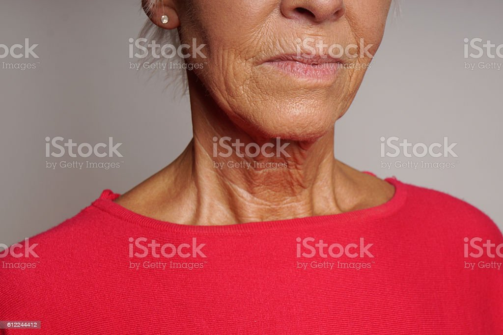 mature woman with wrinkles stock photo