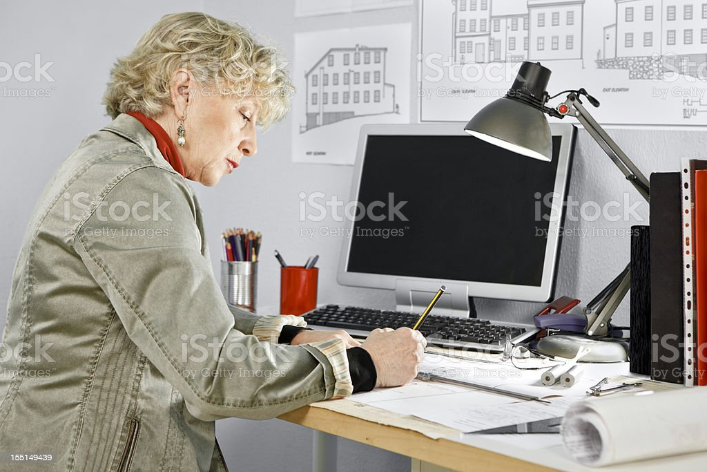 Mature Woman Working at Desk royalty-free stock photo