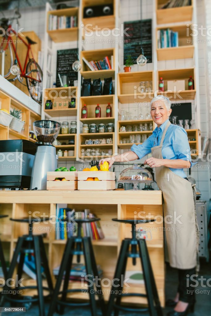 Mature Woman Working In Her Smoothie Cafe stock photo