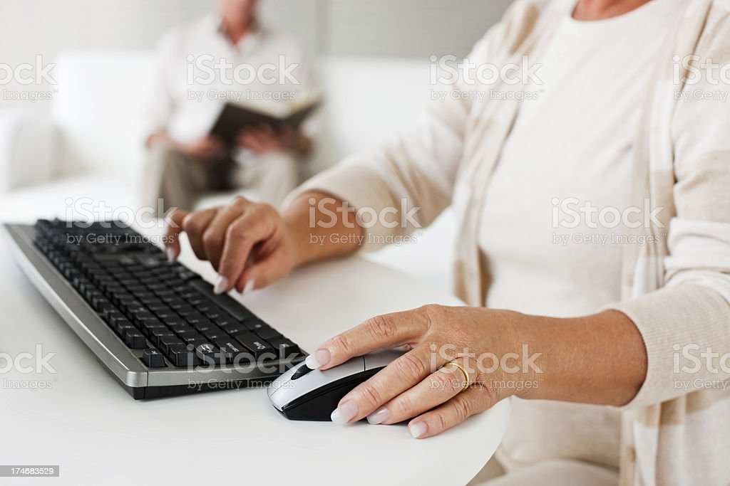 Mature woman working on the computer royalty-free stock photo