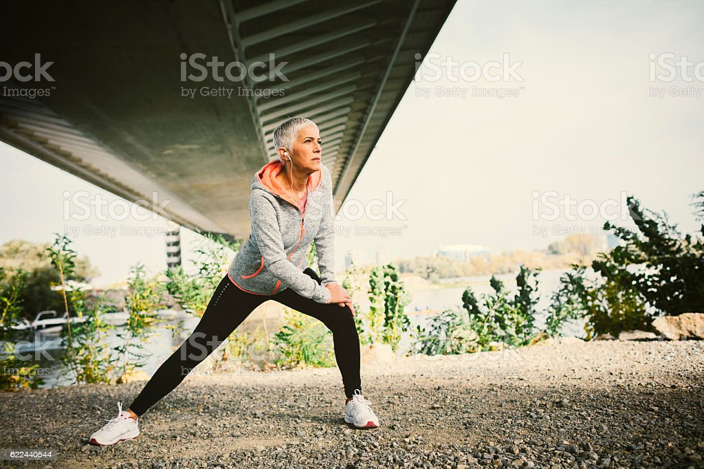 Mature Woman Working Stretching Exercise. stock photo