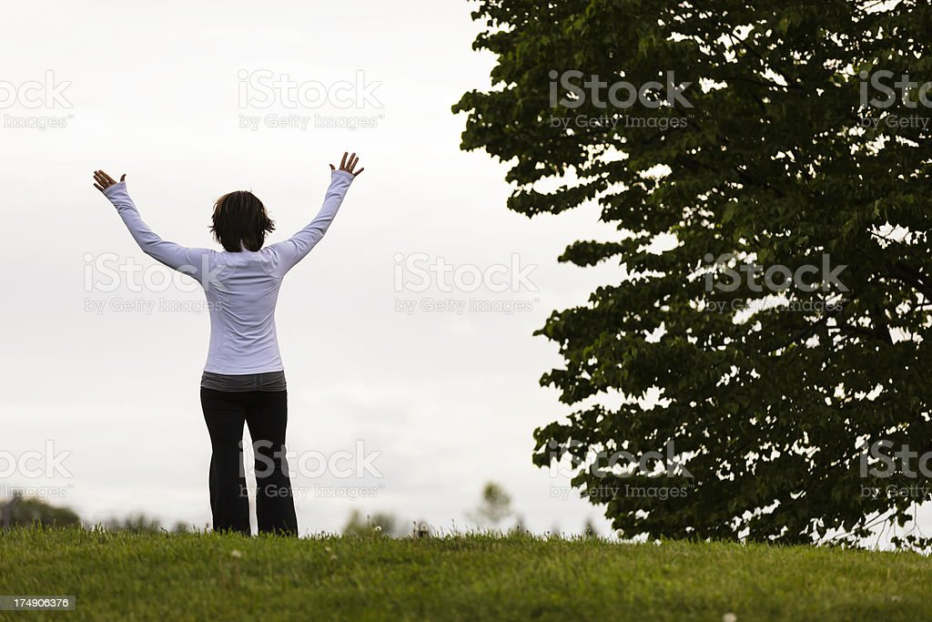 Mature Woman Worshipping outdoors royalty-free stock photo
