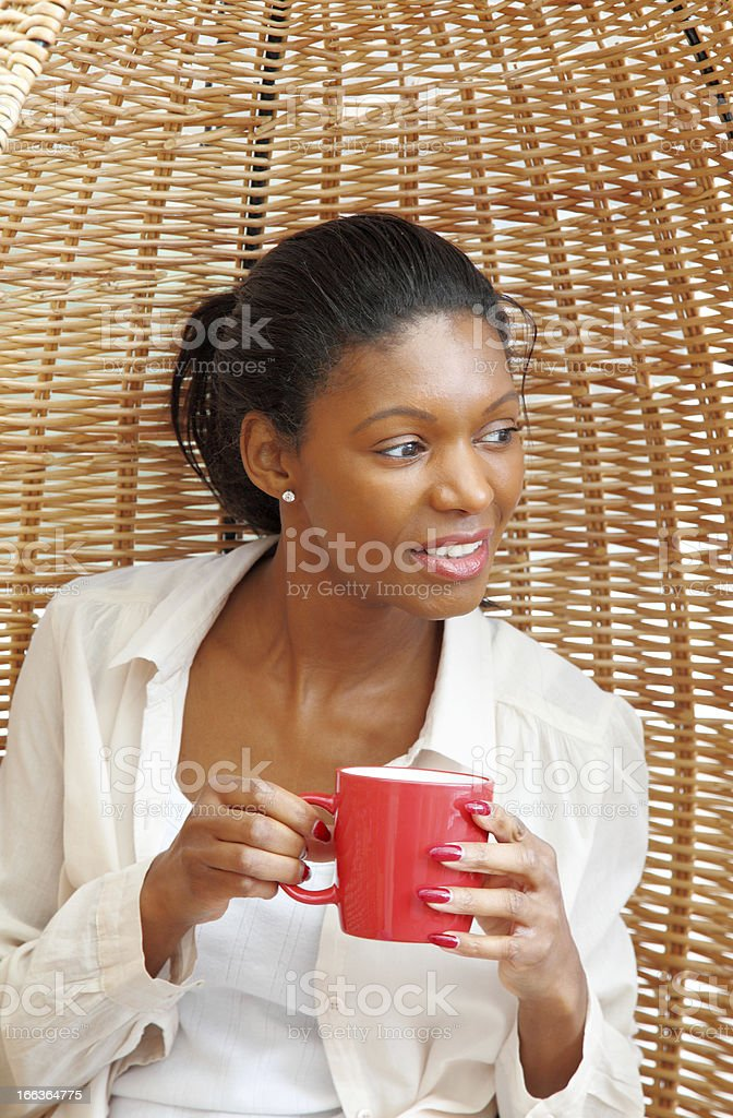 mature women enjoying a mug of coffee royalty-free stock photo