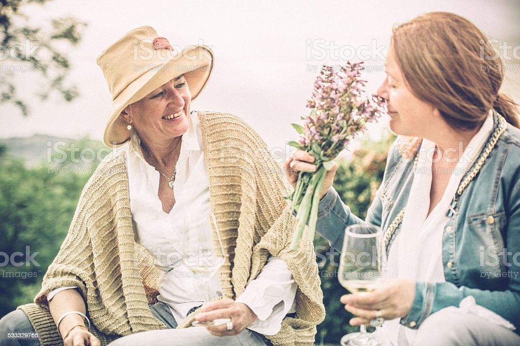 Mature women enjoying with a glass of wine stock photo