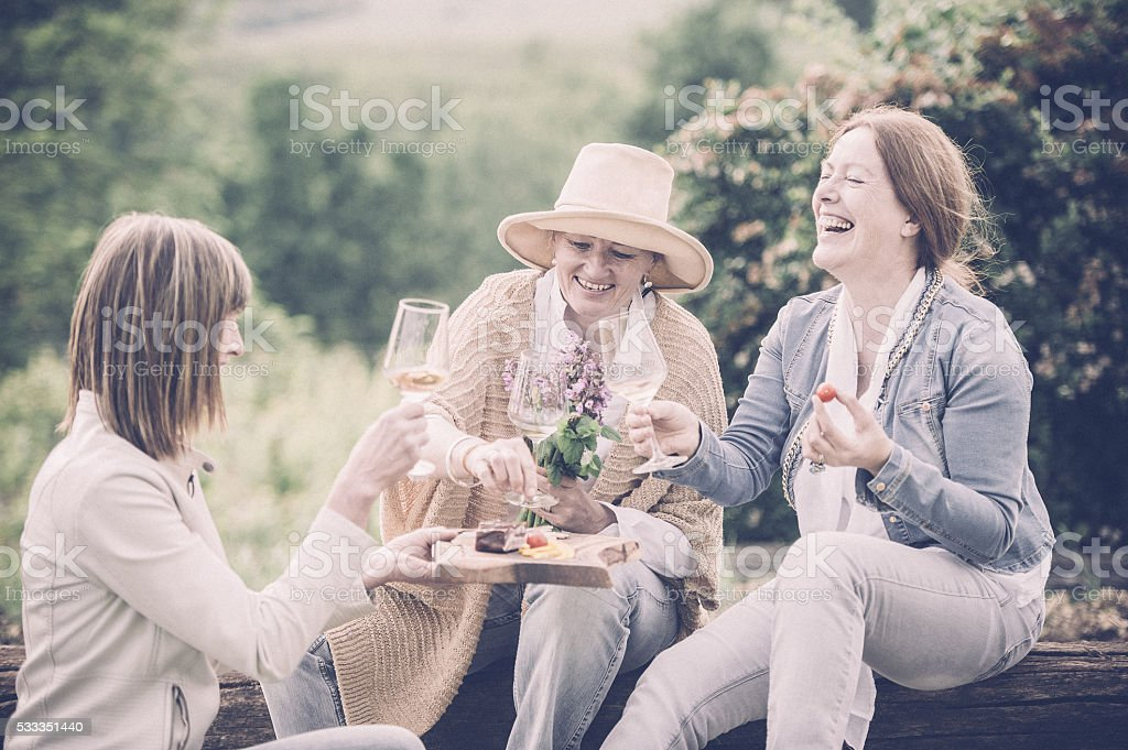 Mature women enjoying with a glass of wine stock photo