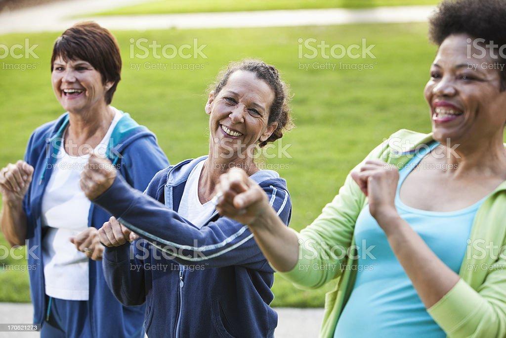 Mature women exercising outdoors stock photo